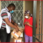 Pastor volunteer of Unisocial delivering boxes of food to someone in need