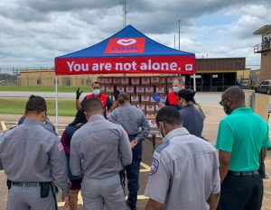 officers and staff receiving prayer outside luther unit in Texas