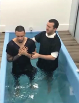 Dyandro being baptized in water