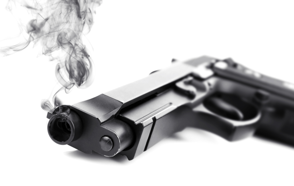 a gun laying down with smoke coming out of its mouth