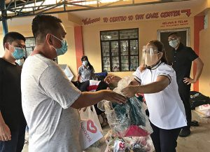 Approximately 700 families received aid from The Universal Church in the Philippines after two typhoons left the country in a state of calamity.